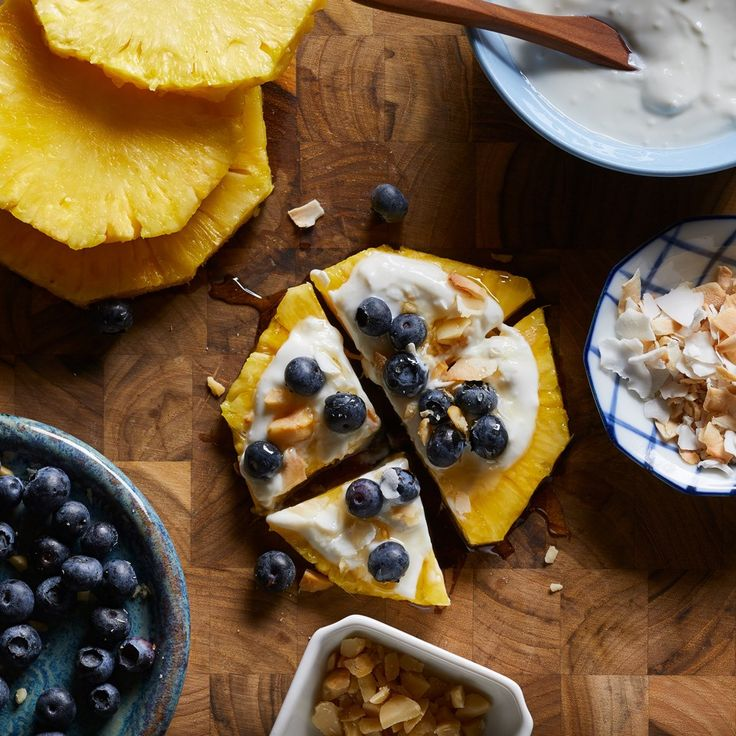 Round slices of fresh pineapple make an easy and deliciously juicy no-bake crust for a healthier fruit pizza that cuts down on carbs from the traditional cookie crust.