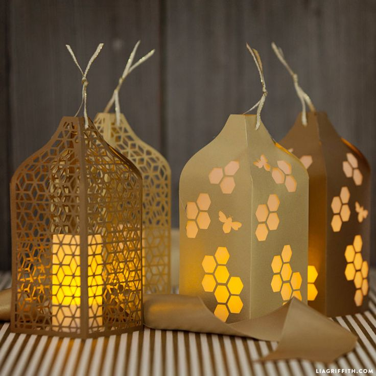 Honeycomb and Bee papercut lanterns.
