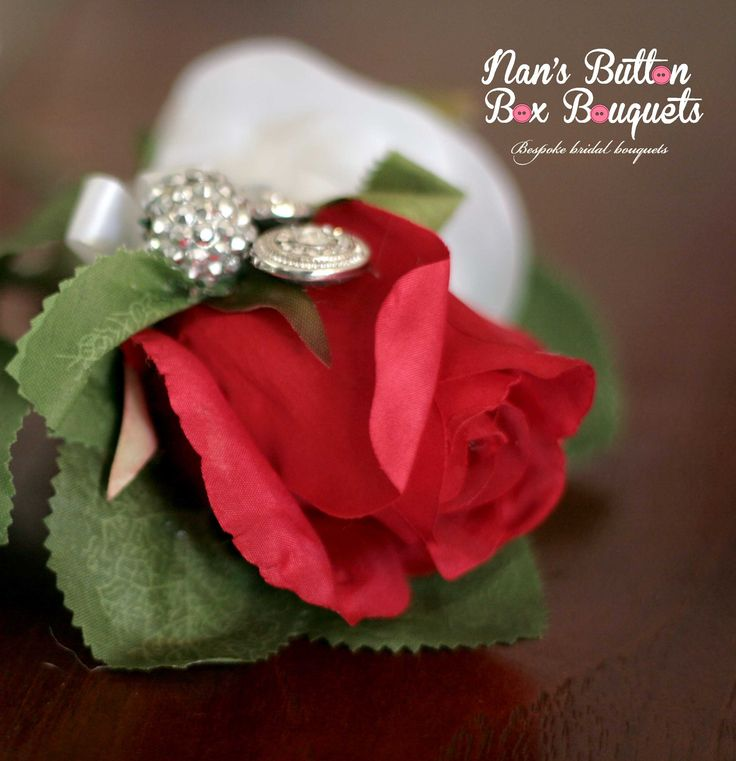 single red rose button hole with just the right amount of bling. Simple yet effective