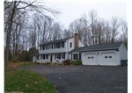 Wonderful opportunity to own this classic center hall colonial in Chesire, CT. With 4 bedrooms and 3.5 baths there is plenty of space for everyone.  Choice of first or second floor masters with full baths. Beautiful 3 season porch off of family size kitchen. Large family room overlooking private 1 acre lot.  Listing Price - $374,900
