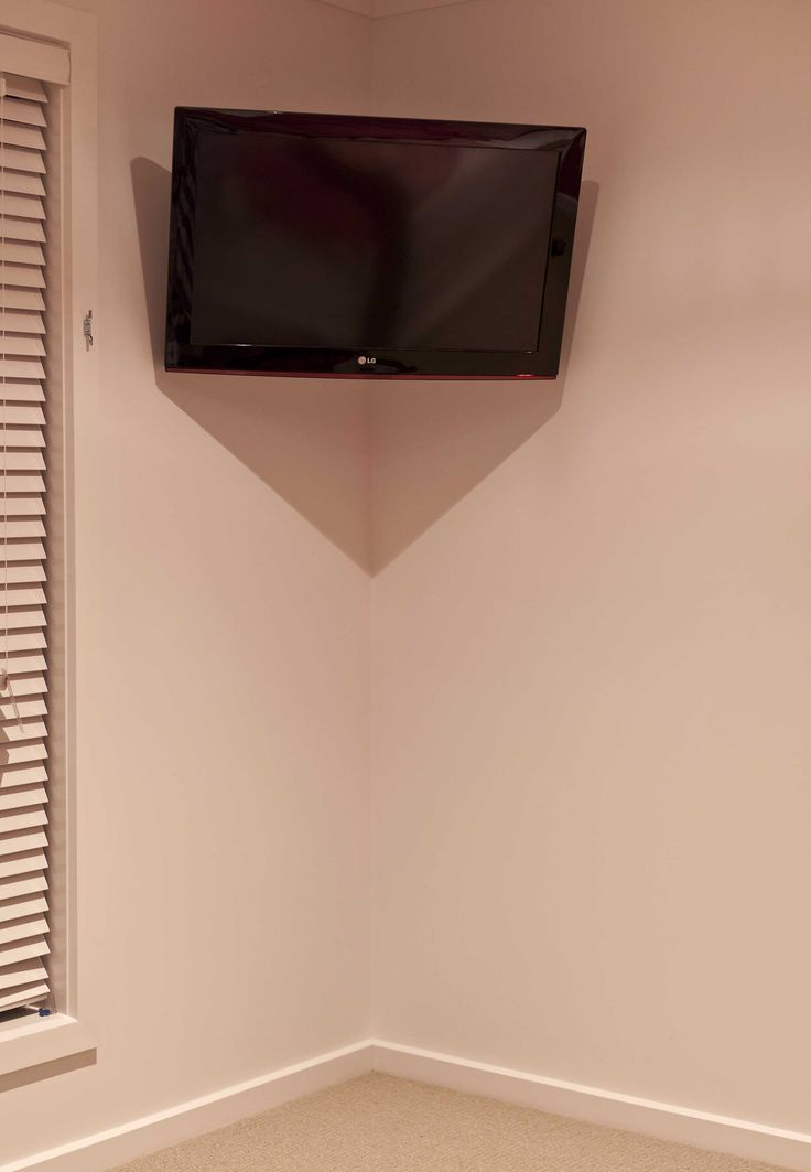 Cool little articulating corner mount which can be installed and folded away as discreetly as possible in a Master Bedroom installed by the Macktronix Albury Wodonga.