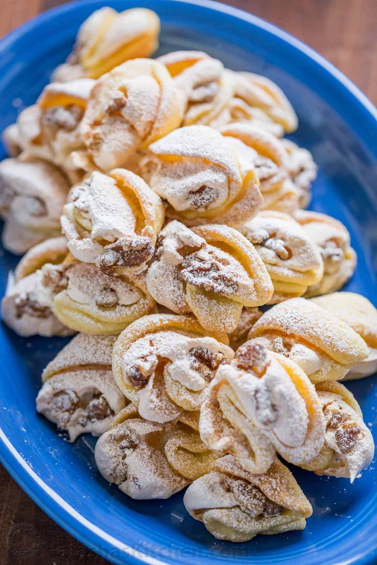 Meringue Shell Cookies have a crisp ribbon of meringue and soft crumbly center. These walnut meringue cookies are completely irresistible Christmas cookies!