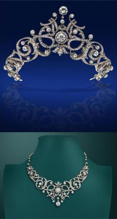A French early 20th century diamond tiara convertible to a necklace, centred with two larger circular transitional-cut diamonds. The foliate scrolling openwork gold & silver mount set overall with graduated circular-cut diamonds. With gold knife edge back section set with circular-cut diamonds to each joint. French control mark to the clasp tongue and unidentified maker's lozenge stamped GR. With two tiara frames, an additional diamond-set silver and gold scroll section to be mounted on one…