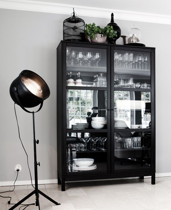 .clean, simple, contemporary version of a china / curio cabinet with mirrored back panel & full glass doors in an ebonized finish.