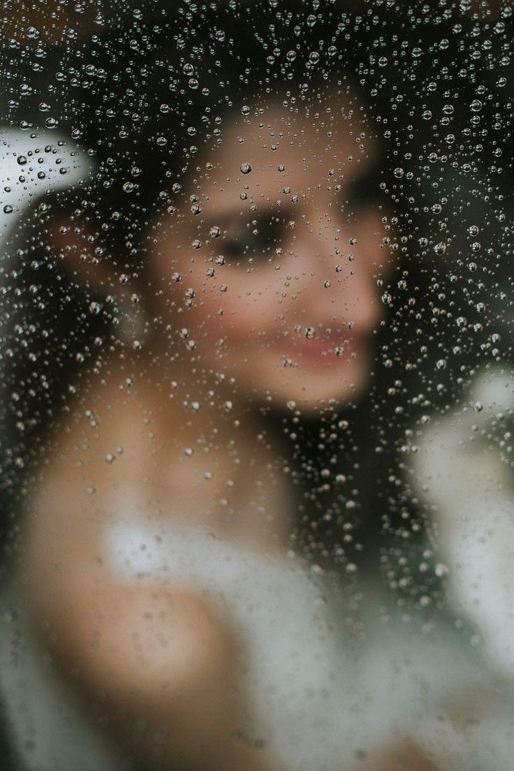 Rainy day wedding portrait of bride in car; PHOTOGRAPHY Joel + Justyna Bedford;