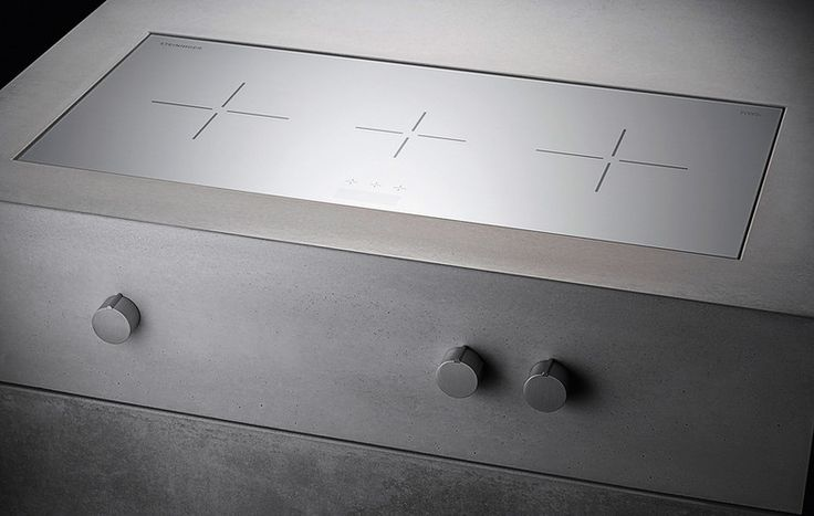 Induction unit as part of the modular, concrete kitchen 'Heart of Gold' by Steininger Designers.