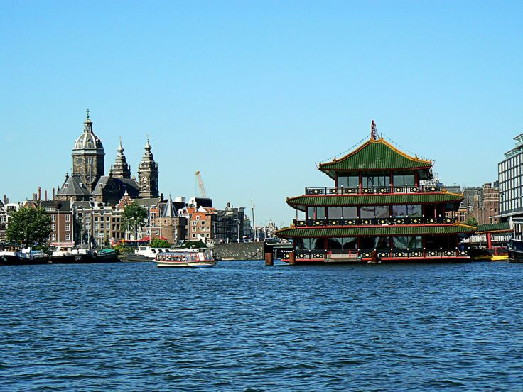 Amsterdam Canal Cruises  - Right is the largest floating pagoda restaurant in Europe. According to the tour guide, the higher up you go in the restaurant, the more expensive it is. It has enough seating for 500 people.