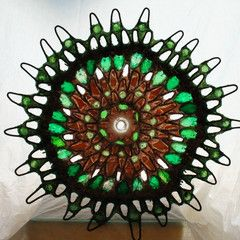 Artist Mariann Taubensee uses EcoPoxy epoxy systems in her recycled art. EcoPoxy uses plant-based oils as diluents making it a truly green epoxy system.