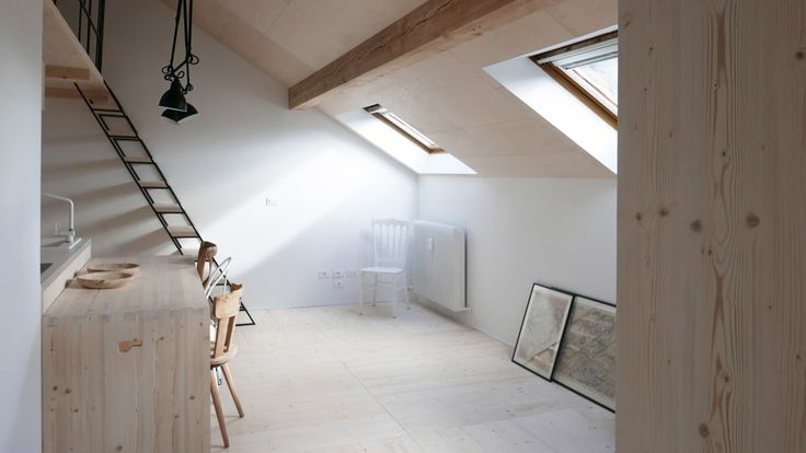 Jab studio has used pale wood, eclectic furniture and black metal to renovate this apartment in northern Italy, featuring skylights that offer views of the south Tyrolean mountains.