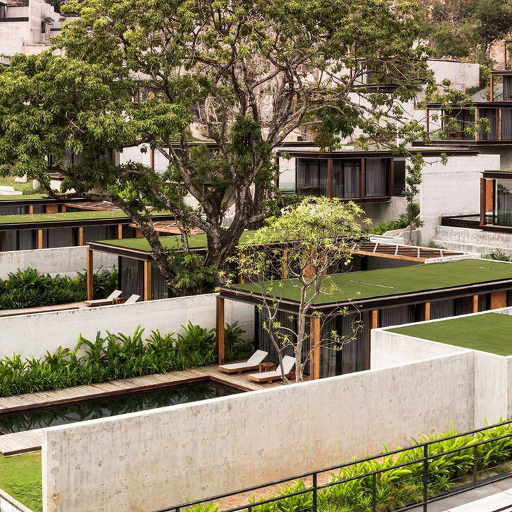 matchbox villas protrude from thai mountainside at naka phuket resort