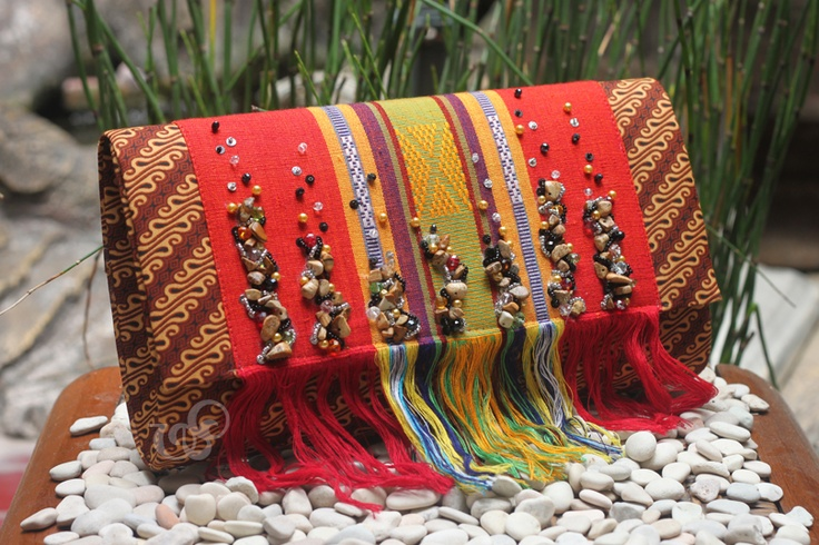 another form of javanese batik and NTB tenun #clutchbag. strong red color looks superb on sogan batik.    #clutchbag #clutch #batikbag #indonesia #ethnicbag #traditional #batik -made for mrs. Melly-