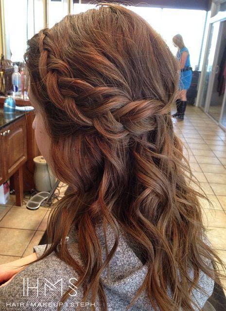 Half up braided curls.
