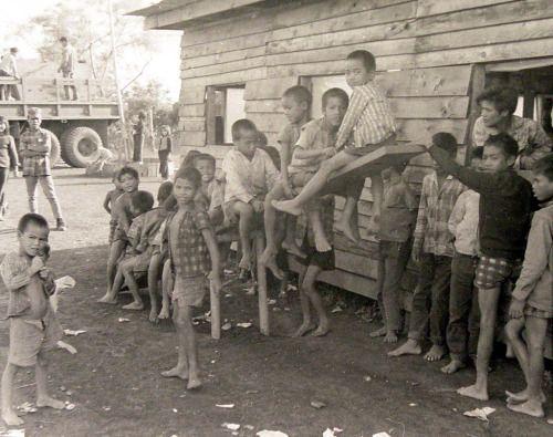 Montagnard children on a see saw.