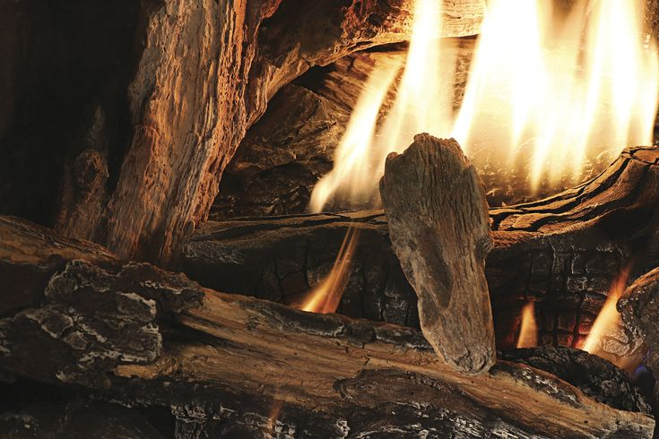 The realistic hand painted PHAZER® log set is rich in detail and creates a towering show of flames while the PHAZER® OAK log set disburses flames across the width of the firebox for a traditional hand built fire appearance.