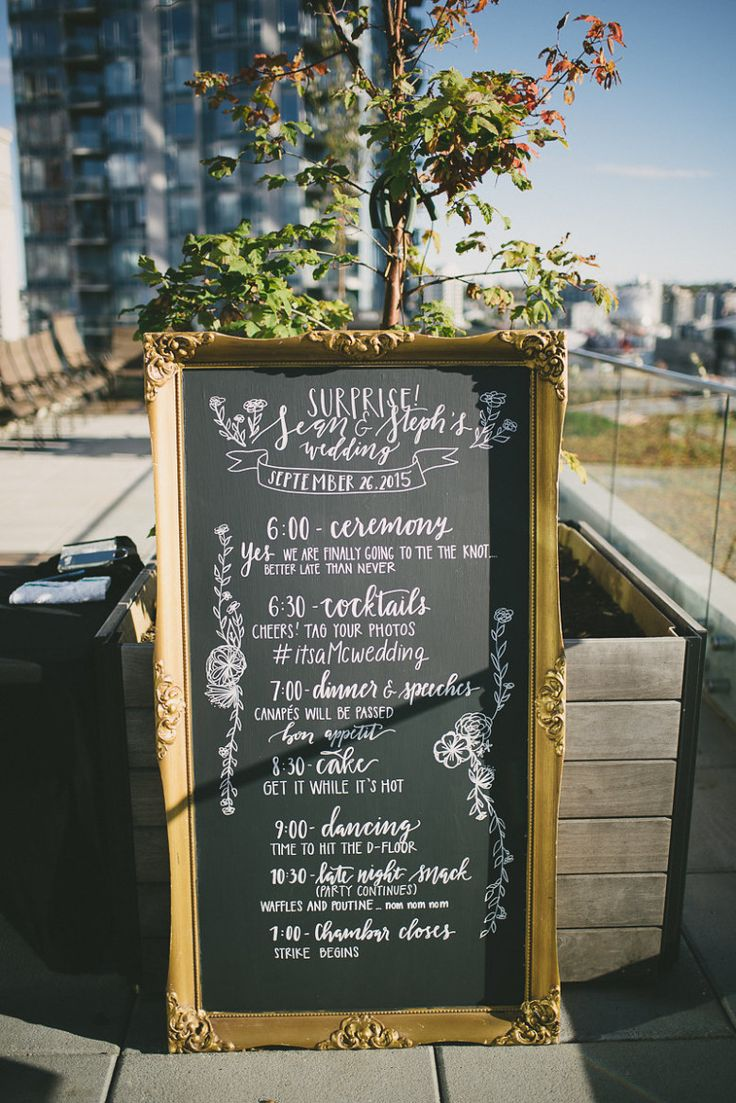 surprise wedding sign decorated with trees