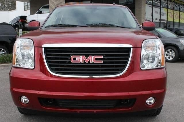 2014 Gmc Yukon SLT 4x2 SLT 4dr SUV SUV 4 Doors Crystal Red Tintcoat for sale in St petersburg, FL Source: http://www.usedcarsgroup.com/new-gmc-yukon-for-sale