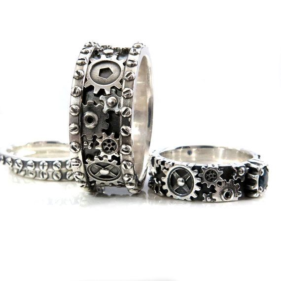 His and Hers Gears and Rivets Wedding Ring Set - Sterling Silver with a Sapphire - Steampunk Gear Ring  I have designed both of these steampunk gear rings using CAD technology. The mens ring is cast in sold sterling silver, it is just over 10mms wide and has been oxidized and then