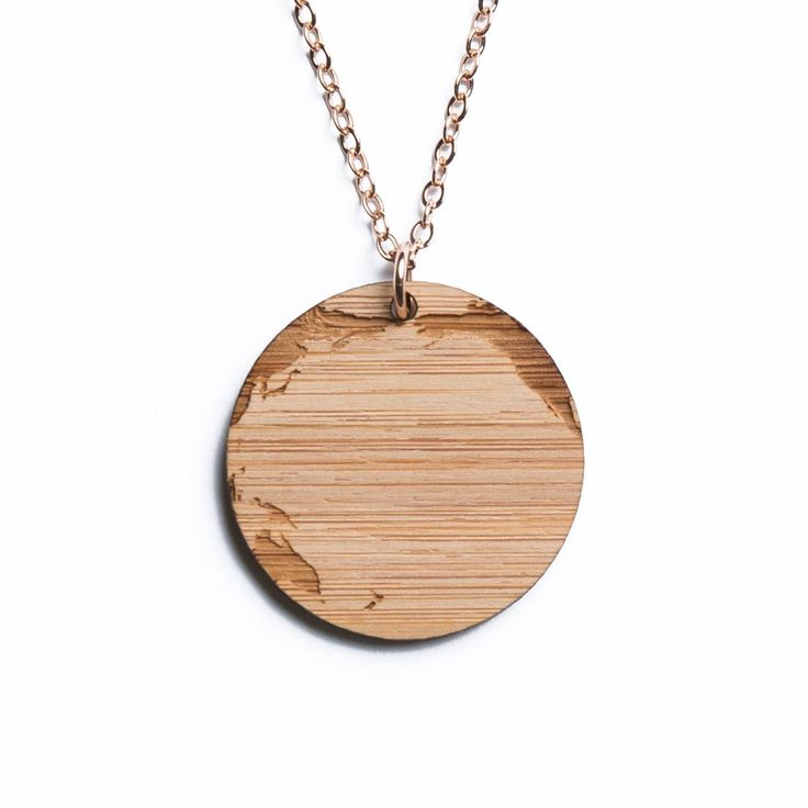 Pacific Ocean map necklace, etched into eco-friendly FSC certified bamboo (using a laser burner), on a recycled rose gold plated sterling silver chain.