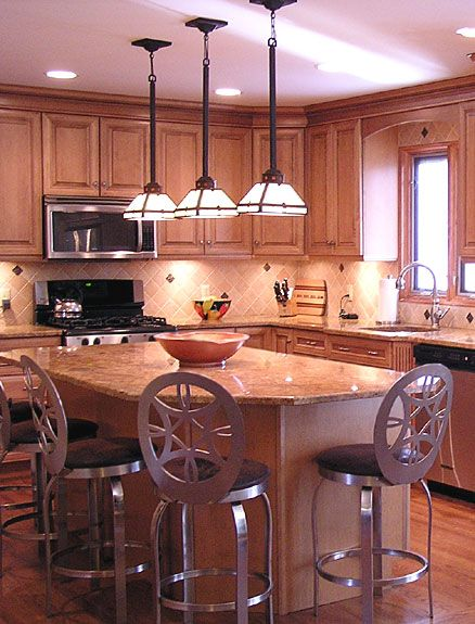 Kitchen island lighting idea - three pendant light fixtures over the island