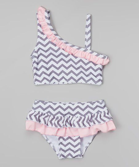 Whether making waves in the kiddie pool or building sandcastles on the shore, a little lady will look positively precious in this ruffle bikini. The top boasts an asymmetrical cut and stay-put straps, while the twirly bottoms feature a snug-fitting elastic waist.