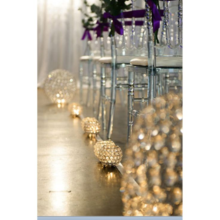 Crystal ball chandeliers used to style aisle hire from AVideas Styling: Amini Concepts