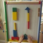 Building with blocks on the sticky easel