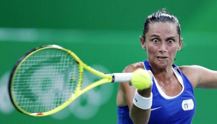 Roberta Vinci, of Italy, returns to Anna Karolina Schmiedlova, of Slovakia, at the 2016 Summer Olympics in Rio de Janeiro, Brazil,…