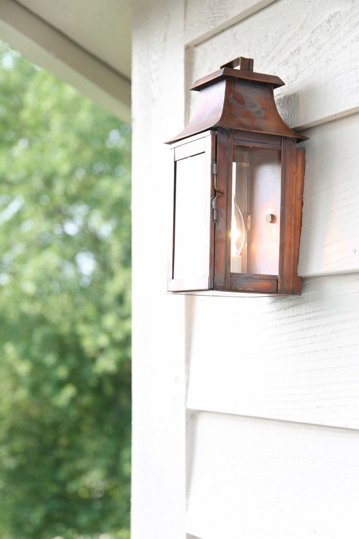 copper lanterns add character that will only be more beautiful with time