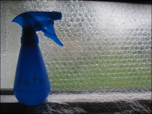 A layer of bubble wrap insulation can actually cut the heat loss from single paned windows in half. To insulate with bubble wrap, just moisten the glass and position the plastic with the bubble side firmly against the wet glass. Some people prefer larger bubbles and claim that they insulate better, but I like using the wrap with smaller bubbles. It creates a nice artistic frosted filter for the glass, and it also makes me think of how a house fly might see the world