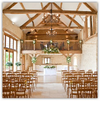 Kingscote Barn in Gloucestershire.  There's something so romantic about getting married in a barn... lovely!