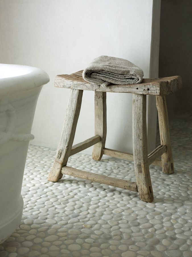 the pebbled floor, rustic stool, vintage tub