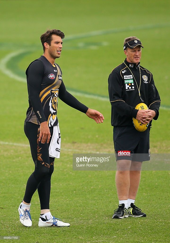 Alex Rance of the Tigers talks to coach Damien Hardwick during a Richmond Tigers AFL training session at ME Bank Centre on April 14, 2015 in Melbourne, Australia.