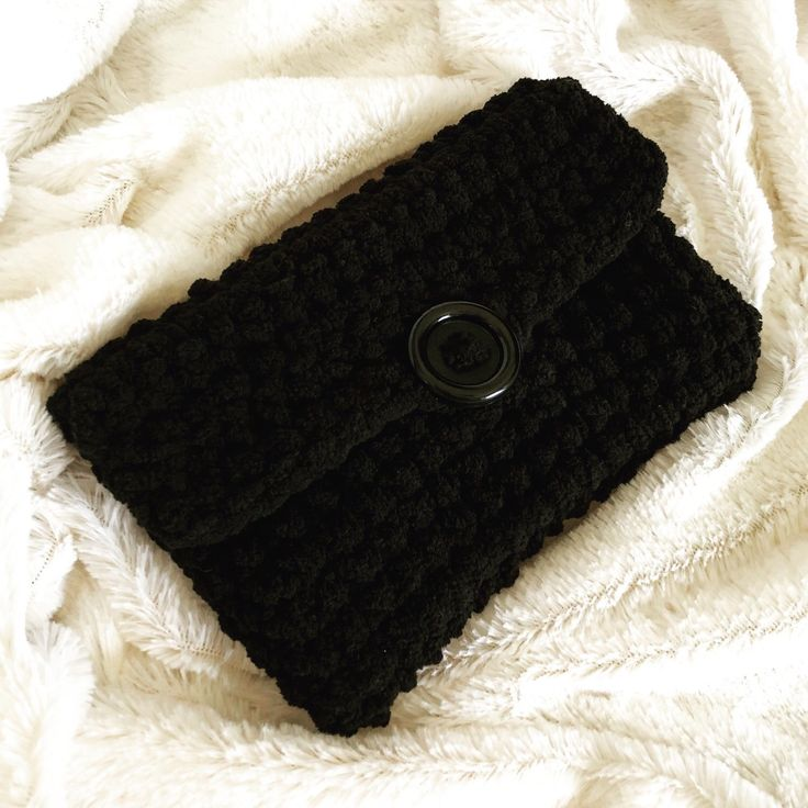A look at the beautiful ✨Black Out!✨ plushy clutch sleeve for the Nintendo 2DS XL. 🖤 Happy Friday! #crochet #yarn #huckleberryhooks #pokemon #pokémon #pokemonart #pokemoncommunity #pocketmonsters #nintendo #gameboy #3DS #2DS #etsy #craft #game #friday