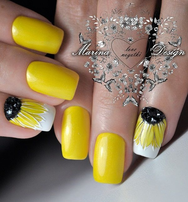 Incredible Sun Flower Themed Nails. Unlike the other sunflower nail art design, this one incorporates black studs and detailed finishing, that looks just incredible with the summer feel.