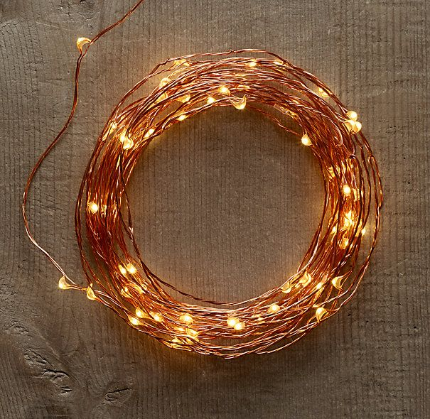 a wreath fashioned from starry string lights in amber lights on copper wire from restoration - Restoration Hardware Christmas Lights