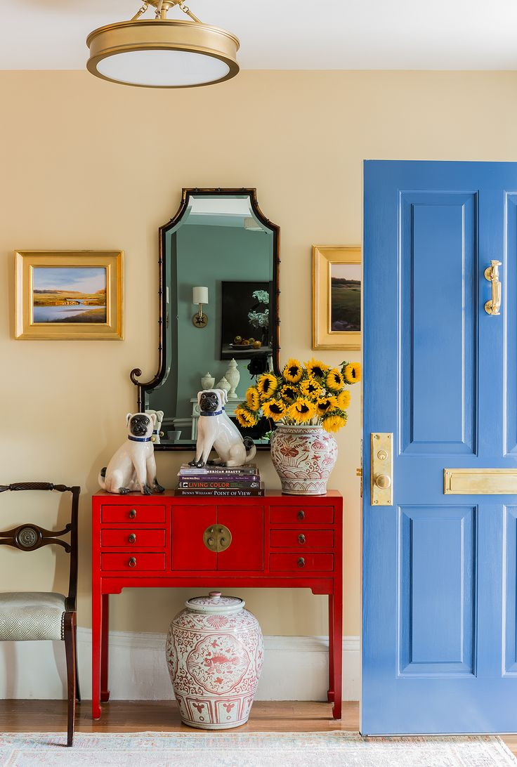 chinese red console, blue door, brass fixtures