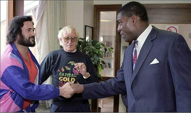Peter Sutcliffe (The Yorkshire Ripper), Jimmy Saville (notorious paedophile) and boxer Frank Bruno meeting in Broadmoor in the '80's. Fucking random picture!