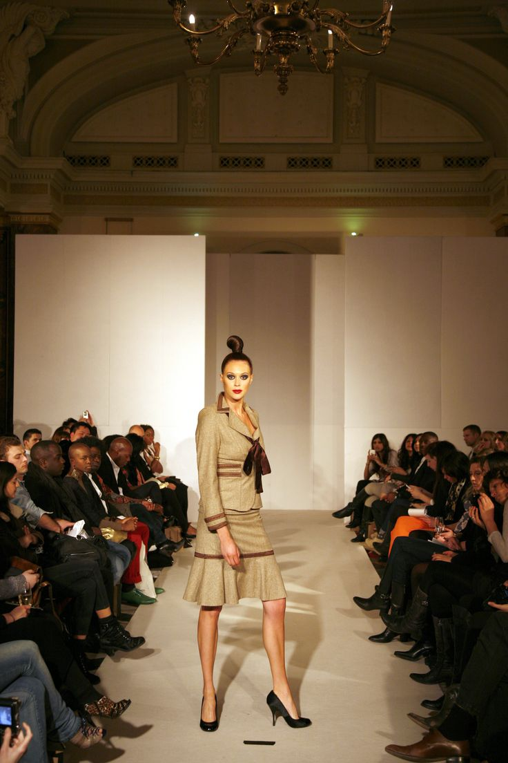 Silk/Wool blend tailored suit with chocolate brown trim on the jacket sleeves and waist with fitted skirt and peplum.