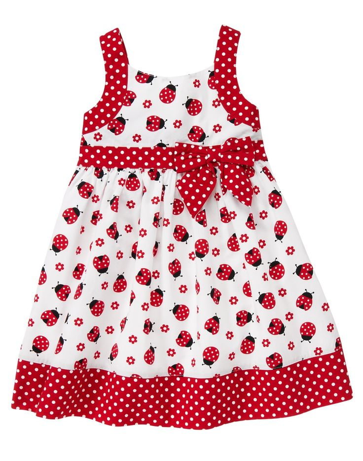 Lovely ladybug. Allover print adds charming style to our light and airy dress, while the polka dot sash with permanent bow offers a touch of sweet detail. Design includes full batiste lining for comfort with a full shirred skirt for extra flounce.