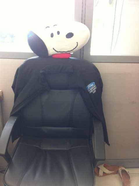 Snoopy guarding our sales rep Catherine Hsu's seat, while she is with clients.