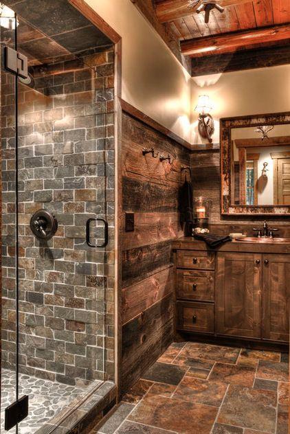 Barn wood walls, alder cabinets, slate tile and river rock tile & a frameless clear glass shower door.