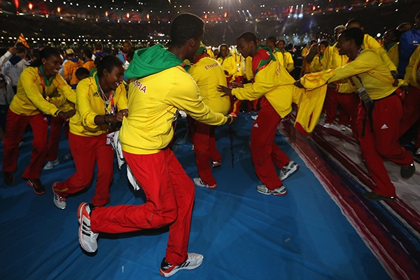 Athletes from Ethopia soak up the atmosphere during the Closing Ceremony on Day 16 of the 2012 Olympic Games at Olympic Stadium on August 12, 2012 in London, England. (Photo by Hannah Johnston/Getty Images)