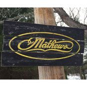 Mathews Archery Wooden sign.