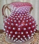 Antique cranberry hobnail pitcher. Cranberry glass is made by adding a bit of gold to a batch of molten glass.  ~ circa 1612, Italian glassmaker Antonio Neri