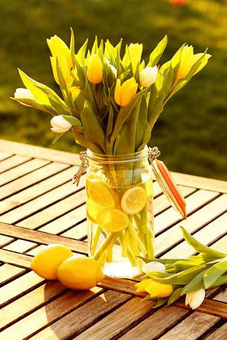 Beautiful spring arrangement with tulips and lemons