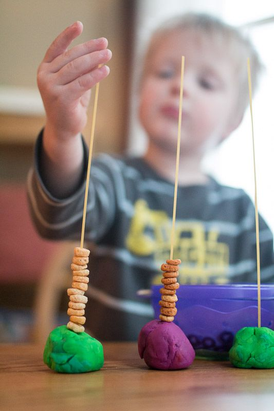 This basic threading activity is super simple to set up. Grabsome play dough, spaghetti and some cereal to thread! Make patterns, sort, count!