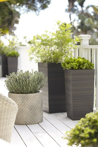 Clean taper shapes in graduated slats have the look of wood with the easy-care of plastic, making them a natural for outdoor use. Grey wash finish adds to the organic look.