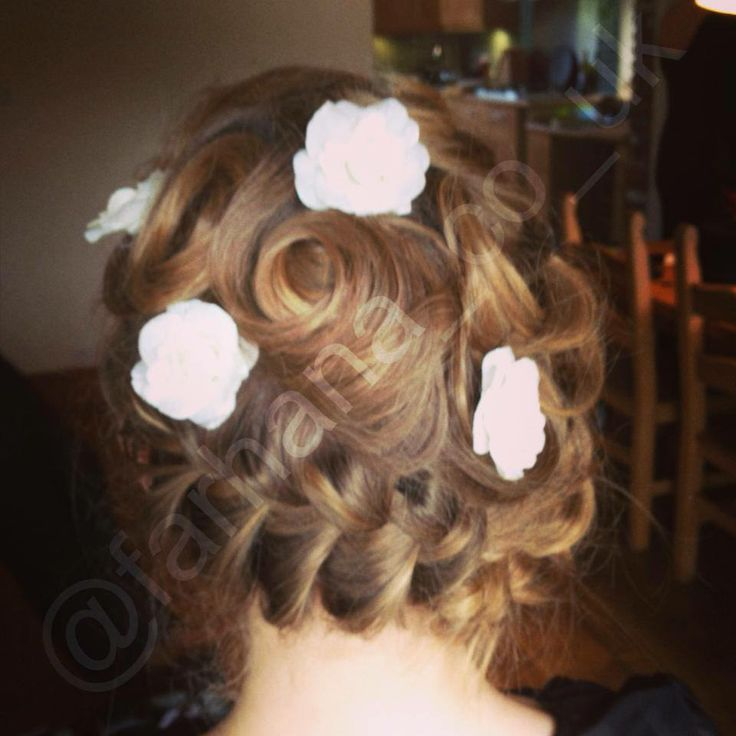 Gorgeous rose-embellished hair-do. Lovely wedding look. www.farhana.co.uk #bridal #wedding #hair #style #mua