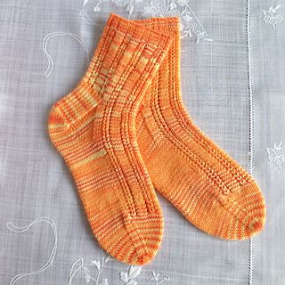 Solar socks by Gill Slater are bright and cheerful, and the pattern is very nice. Pick up some bright yarn and download Gil's pattern - it's free on Ravelry!