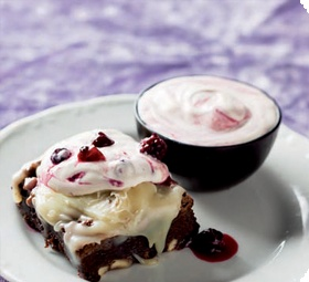 Brownies with creme frache and berries in syrup